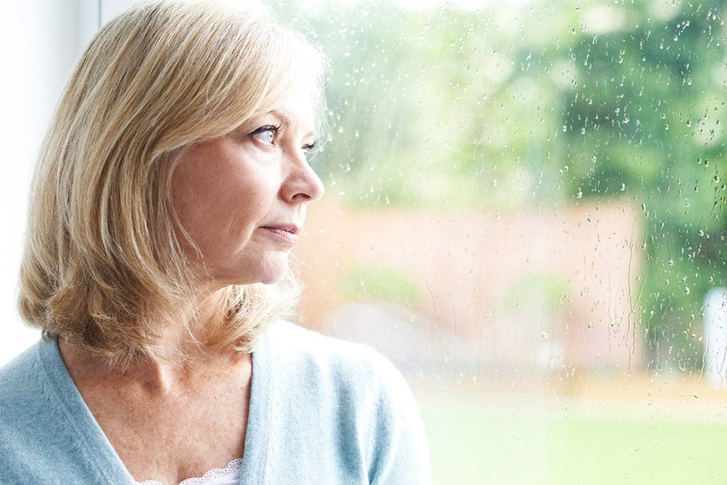 anxious woman looking at the window